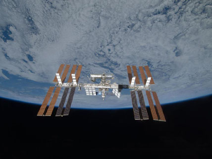 The international space station with all 4 solar arrays. Click for a high resolution version
